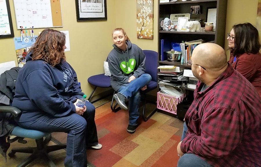 Members of the Journeys: The Road Home clinical team, including, from left, Housing Case Manager Michelle Dubil, Vocational Case Manager Mandy Smith, Corner Case Manager Marie Bulfer and Hope Center Manager Jon Rapp, meet to discuss the agency's response to the coronavirus pandemic.