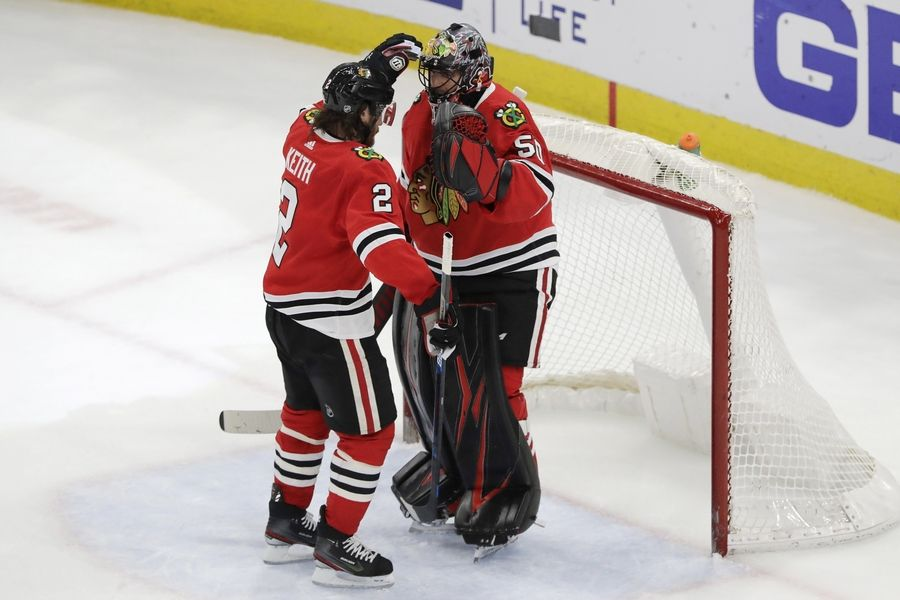 Blackhawks defenseman Duncan Keith celebrates with goalie Corey Crawford after the Blackhawks defeated the Edmonton Oilers 4-3 March 5 at the United Center.