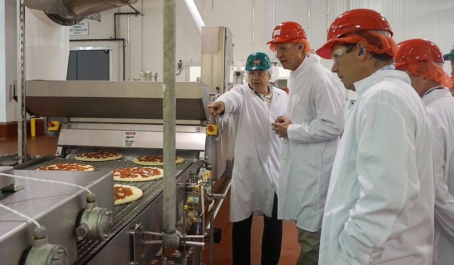 Former Gov. Bruce Rauner learns about the process for making pizzas when he visited the Richelieu Foods Inc. plant when it opened in Wheeling in 2016. Former U.S. Rep. Bob Dold joined Rauner on the tour.
