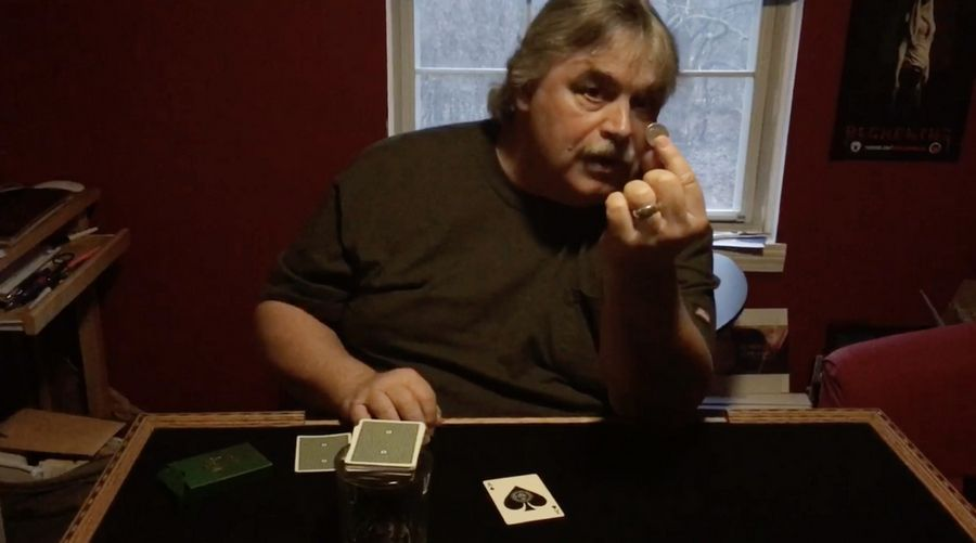 "With COVID-19 canceling his gigs, Island Lake magician Mark Doetsch sits in his ""magic room"" at home and puts out a video of one of his tricks."