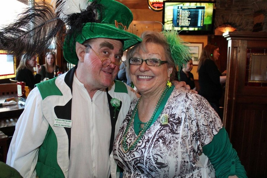 "Pete Kovacevich of Palatine, with his face-painting wife, Barb, made his last performance as a leprechaun on the Sunday before St. Patrick's Day. Since then, the ""shelter in place"" order has canceled all his gigs."