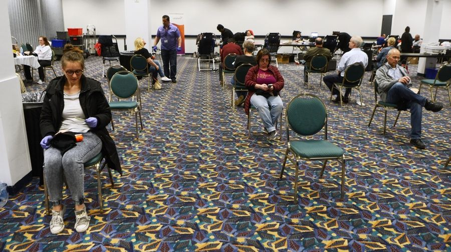 Sara Hernandez waits to be screened at Wednesday's blood drive at the Skyline Room across from the Allstate Arena in Rosemont. The chairs were separated in the interest of social distancing.