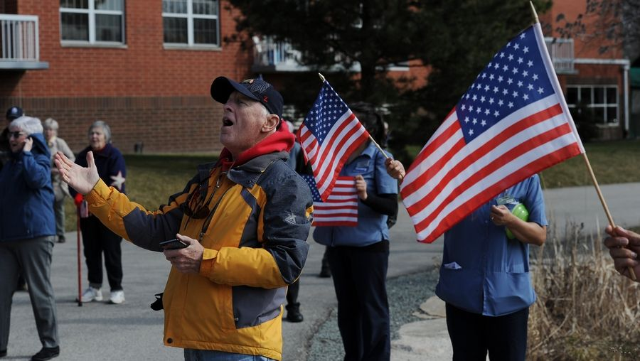 "George Richter, 84, sings ""God Bless America"" with about 100 other residents of the Moorings of Arlington Heights retirement community Wednesday."