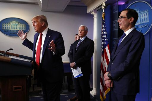 President Donald Trump speaks about the coronavirus in the James Brady Briefing Room, Wednesday, March 25, 2020, in Washington as Vice President Mike Pence and Treasury Secretary Steven Mnuchin listen.