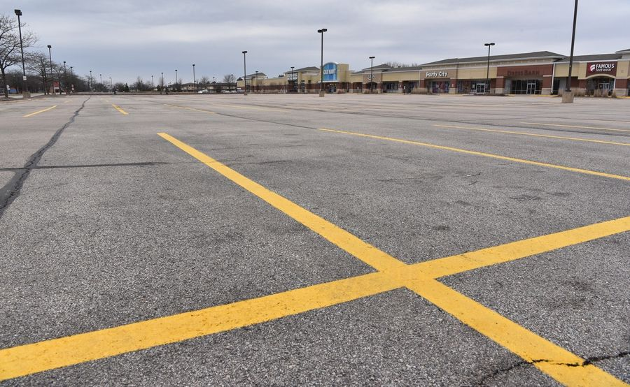 The parking lot of a strip mall in Geneva is nearly empty as one store remains open.