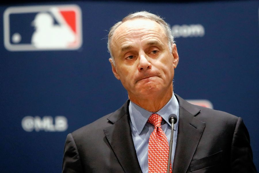 Major League Baseball Commissioner Rob Manfred says he's optimistic the game will return sometime in May.