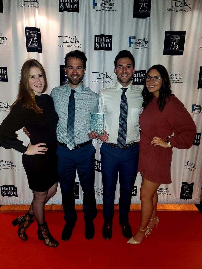 From left, Amanda Hurst, Bradley Cesaroni, Brandon Cesaroni and Jordan McQuade attend the Woodstock Area Chamber of Commerce 75th annual awards banquet Feb. 29. Cesaroni's Cafe & Deli won the Retailer of the Year award.