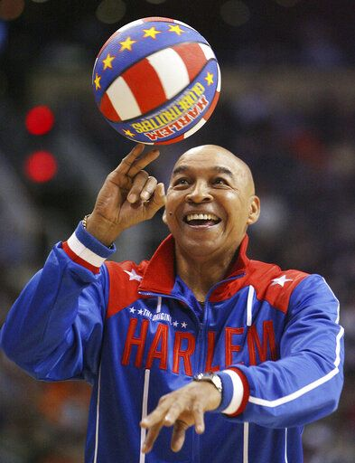 "The Harlem Globetrotters' Fred ""Curly"" Neal performs during a timeout in the second quarter in an NBA basketball game between the Indiana Pacers and the Phoenix Suns in Phoenix. Neal, the dribbling wizard who entertained millions with the Harlem Globetrotters for parts of three decades, has died the Globetrotters announced Thursday, March 26, 2020. He was 77. Neal played for the Globetrotters from 1963-85, appearing in more than 6,000 games in 97 countries for the exhibition team known for its combination of comedy and athleticism."