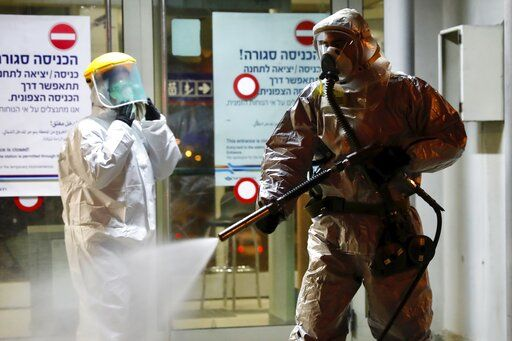 '�A firefighter sprays disinfectant as a precaution'� against the coronavirus at the Moshe Dayan Railway Station in Rishon LeTsiyon, Israel, Sunday, March 22, 2020.
