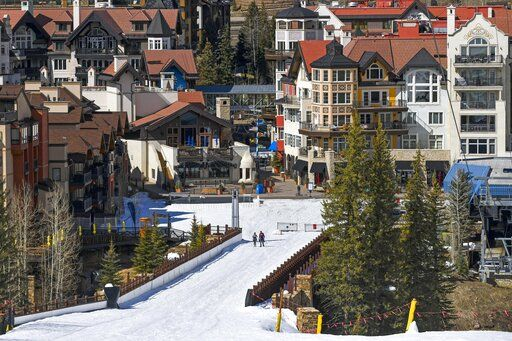 "In this Tuesday, March 24, 2020, photo it is mostly deserted after the Vail Ski Resort closed for the season amid the COVID-19 pandemic, in Vail, Colo. Ski resorts across the West that were shut down amid coronavirus fears are grappling with an economic 'œbody blow"" at a time when they normally would be welcoming hoards of spring break revelers."