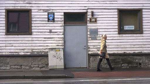 A woman walks past a methadone treatment center in Estonia's capital Tallinn on Friday, June 28, 2019. The tiny Baltic state has battled nearly two decades a fentanyl epidemic so severe its overdose death rate was almost six times the European average. Although police won the war on fentanyl the market shifted further towards synthetic drugs.