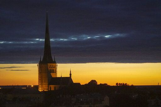 Dusk falls over Estonia's medieval capital, Tallinn, Thursday, June 27, 2019. The small Baltic nation spent more than a decade fighting fentanyl drug abuse. Although police won the war on fentanyl the market shifted further to synthetic drugs.