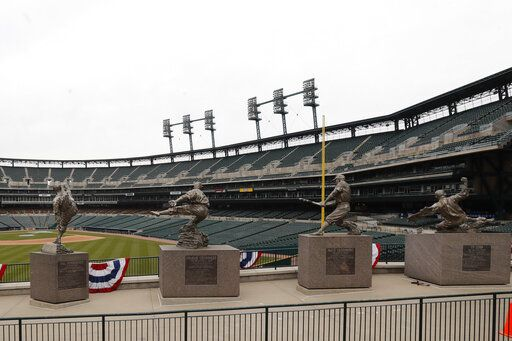 The statues of, from left, Hal Newhouser, Charlie Gehringer, Hank Greenberg and Ty Cobb stand in left field inside Comerica Park, home of the Detroit Tigers baseball team, Thursday, March 26, 2020, in Detroit. The start of the regular season, which was set to start on Thursday in Cleveland and on Monday in Detroit, is on hold indefinitely because of the coronavirus pandemic.