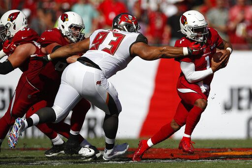FILE - In this Nov. 10, 2019, file photo, Tampa Bay Buccaneers nose tackle Ndamukong Suh (93) brings down Arizona Cardinals quarterback Kyler Murray (1) during an NFL football game in Tampa, Fla. The Buccaneers announced Thursday, March 26, 2020, that the team had re-signed defensive lineman Ndamukong Suh.