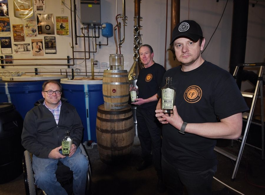 After hearing that police and fire departments didn't have enough hand sanitizer, state Sen. Dan McConchie, left, called the owners of Copper Fiddle Distillery in Lake Zurich, Andrew Macker, right, and Jim Iverhouse to make some. Macker said Friday they will continue to produce for first responders but aren't getting into producing sanitizer for consumers.