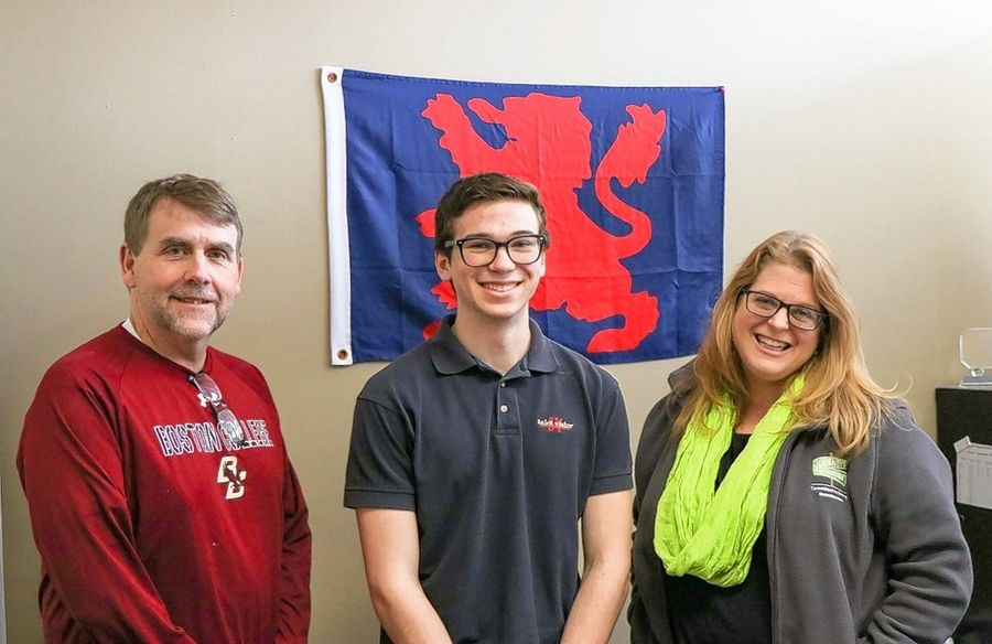 John O'Neill, a junior at St. Viator High School in Arlington Heights, has started a GoFundMe campaign to pay for hotel rooms for the homeless during the pandemic. From left are Fr. Corey Brost, CSV, of St. Viator; O'Neill; and Beth Nabors, executive director of Journeys: The Road Home.