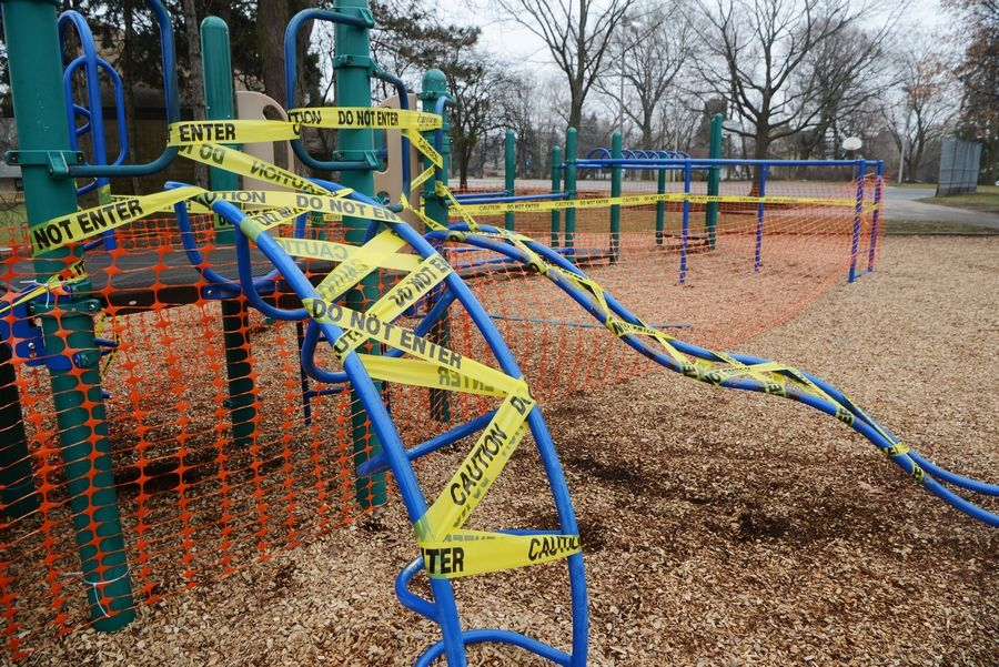 The playground behind Gray M. Sanborn School adjacent to Community Park in Palatine is closed, and caution tape has been placed on the equipment.