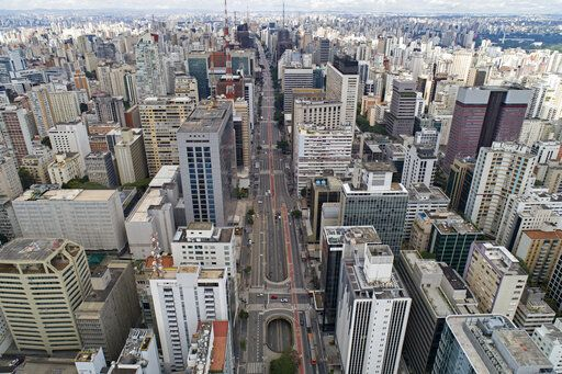 An aerial view of the almost empty Paulista Avenue, on the city's all important financial center, on the first day of quarantine to help stop the spread of the new coronavirus, in Sao Paulo, Brazil, Tuesday, March 24, 2020.