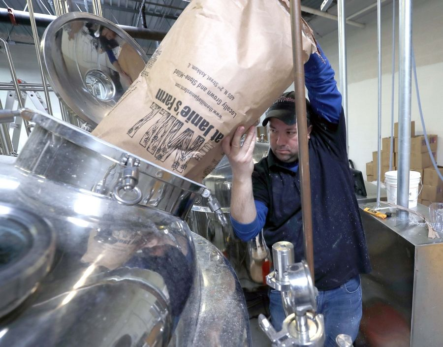 Jesse Zien, Two Eagles Distillery operations manager, pours ingredients into what will become hand sanitizer. A year ago, two Eagle Scouts received approval to open in Mount Prospect. They have shifted to making hand sanitizer, raising funds with a GoFundMe page to donate the result to local first responders.