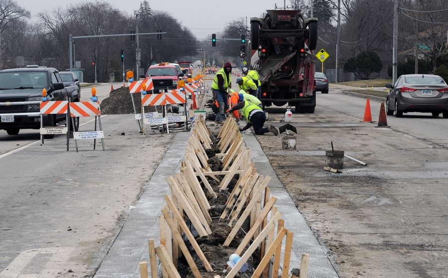Construction has been deemed an essential business under the state's stay-at-home order, so drivers shouldn't expect a break this spring. Here crews are at work on Golf Road in Des Plaines.