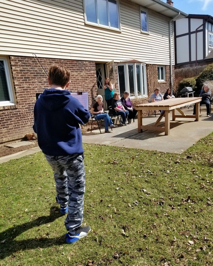 The son of a Clearbrook employee plays his violin for residents of a local Community Integrated Living Arrangement home.