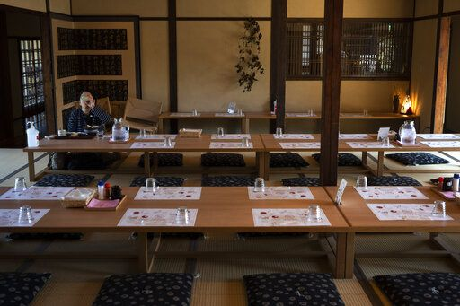 A tourist eat her lunch in a restaurant in Nara, Japan, March 19, 2020. Nara was among the first Japanese town hit by the COVID-19 in late January, when a tour bus driver in town tested positive for the virus, becoming the first Japanese patient after carrying tourists from Wuhan, the epicenter of the pandemic.