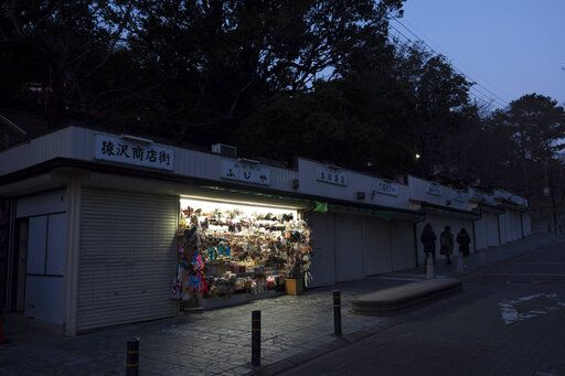 Tadayuki Takiguchi's souvenir shop remains open in Nara, Japan, March 17, 2020. Nara was among the first Japanese town hit by the COVID-19 in late January, when a tour bus driver in town tested positive for the virus, becoming the first Japanese patient after carrying tourists from Wuhan, the epicenter of the pandemic.