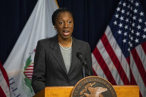 Dr. Ngozi Ezike, director of the Illinois Department of Public Health, speaks at the Thompson Center in Chicago during the daily update on the state's response to the coronavirus pandemic, Monday, March 30, 2020. (Ashlee Rezin Garcia/Chicago Sun-Times via AP)