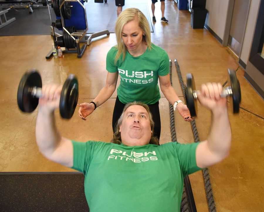 2020 Daily Herald Fittest Loser contestant Neil Madden works with free weights trainer Nicole Caliva at Push Fitness in Schaumburg.