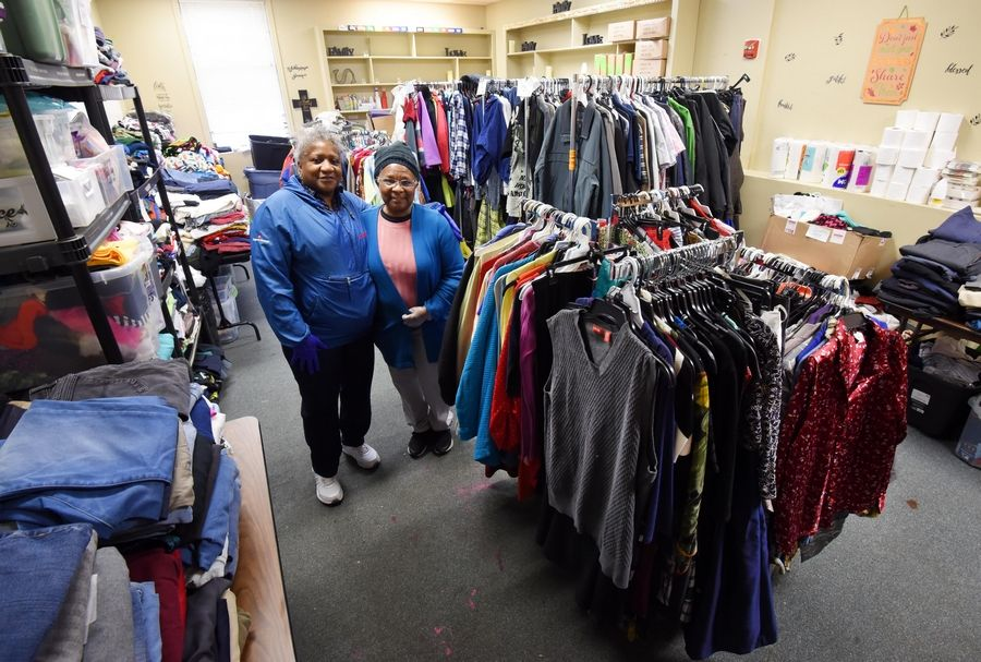 "Geraldine Milton and Doris Glenn, members of the New Life Covenant Church in Elgin, operate a ""Jesus closet"" at the church, which offers donated clothing to the homeless that stay there."