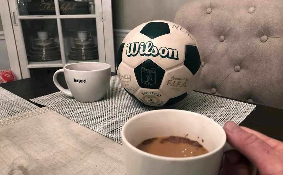 """In the midst of changing our lives, we began to miss our weekly grind of two soccer practices and one or two soccer games on the weekends for our twin 9-year-old daughters,"" says the Nero family of Hoffman Estates. ""Early on, my mind went to the vintage 1980s Wilson soccer ball from my childhood, which my parents brought to me in the last year. Of course, it's not the cool new balls that the kids use nowadays, but the movie ""Cast Away"" and Tom Hanks brought this idea to mind. I call it 'Soccer Sunday coffee with Wilson.'"""
