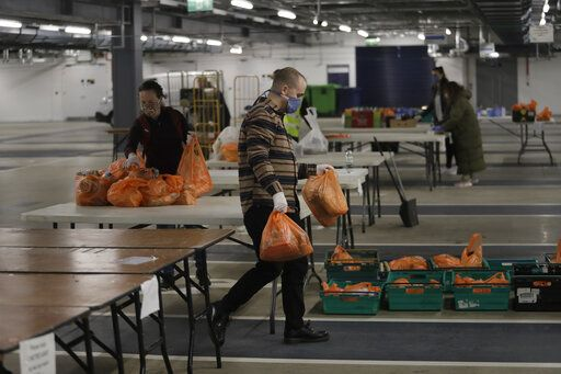 Volunteers for the Edible London food project sort donated food and essential items, to be delivered to vulnerable residents in the Harringey Council, at a hub setup as a result of Coronavirus inside the Tottenham Hotspur Stadium, in north London, Wednesday, April 1, 2020. Many elderly and vulnerable people have difficulty to get shopping with reduced bus and train services due the government asking only essential workers travel during this Covid-19 lockdown to stop its spread. The new coronavirus causes mild or moderate symptoms for most people, but for some, especially older adults and people with existing health problems, it can cause more severe illness or death.