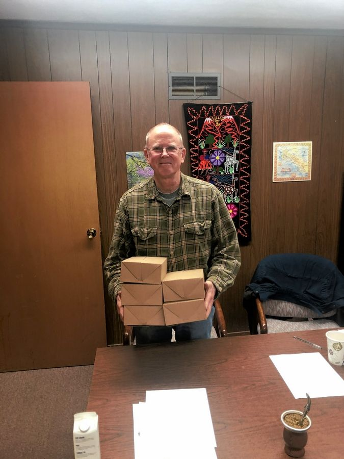 David Falbacher delivers food for his apartment complex as part of the DuPage Mutual Aid & Solidarity Network.