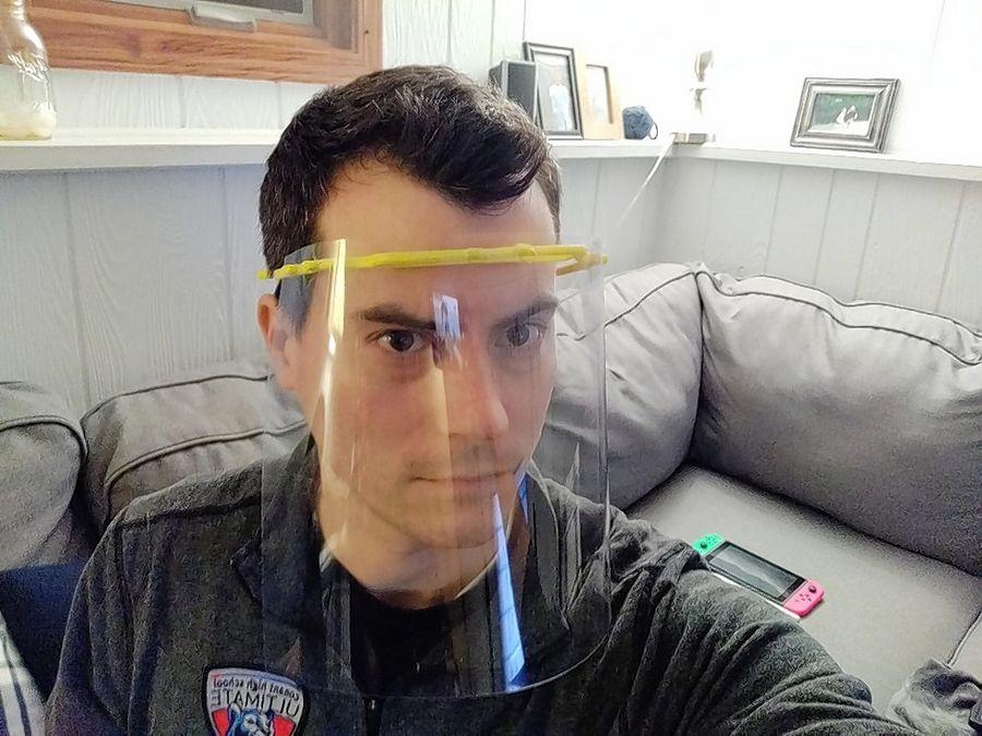 David Torpe, a Conant High School science teacher, demonstrates a face shield he built.