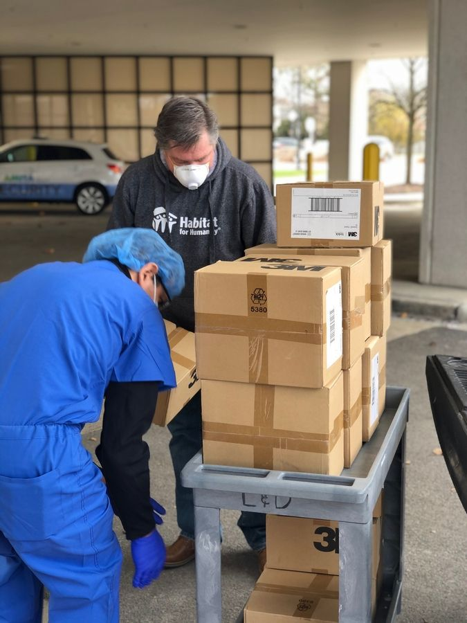 Dave Neary, executive director of DuPage Habitat for Humanity, delivers over 1,000 units of personal protective equipment to emergency room Dr. Ted Patras at Amita Health's LaGrange location.