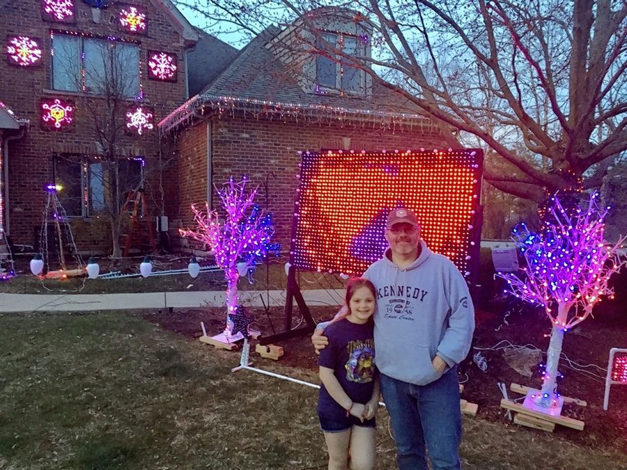 Brett Foy and his daughter Sierra, 11, have spent the last three weeks working to build a new light display at their Batavia home.