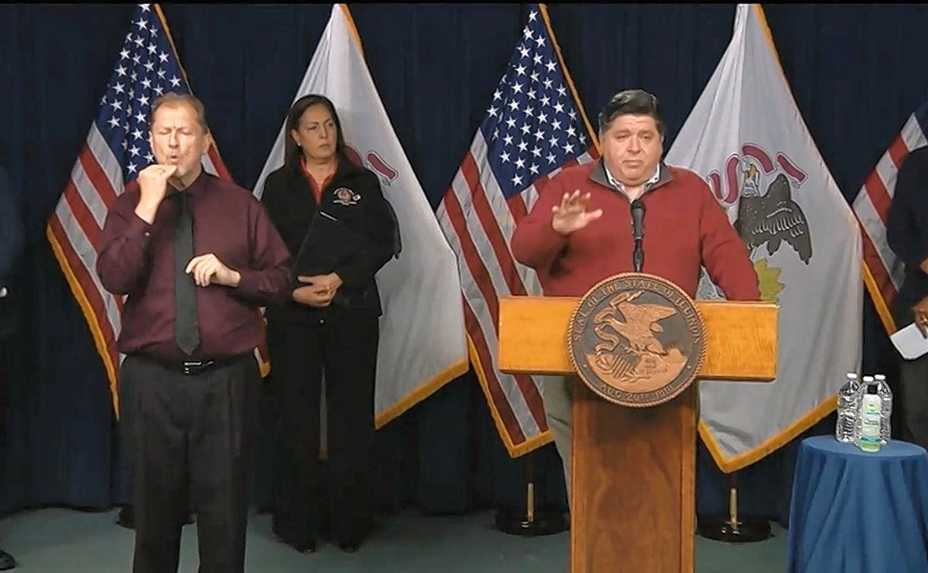 "Gov. J.B. Pritzker speaks during a news conference Saturday in Chicago. When he was asked to comment on Illinois residents who still aren't practicing social distancing to help slow the spread of novel coronavirus, Pritzker said, ""All I can say is, those people either are not paying attention to the news or they're stupid."""