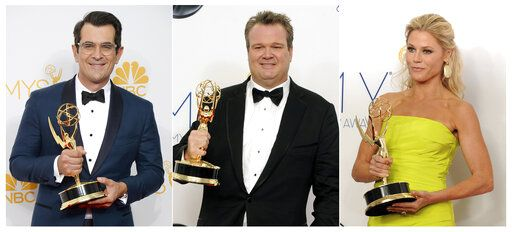 "This combination photo shows award winning cast members of ""Modern Family"", from left, Ty Burrell with the Emmy for supporting actor in a comedy series at the Emmy Awards in Los Angeles on Aug. 25, 2014, Eric Stonestreet with his award for best supporting actor in a comedy series at the Emmy Awards in Los Angeles on Sept. 23, 2012 and Julie Bowen with her award for best supporting actress in a comedy series at the Emmy Awards in Los Angeles on Sept. 23, 2012. Each actor has won two supporting awards during the series' 11-season run. The two-hour finale airs at 9 p.m. EDT on Wednesday."