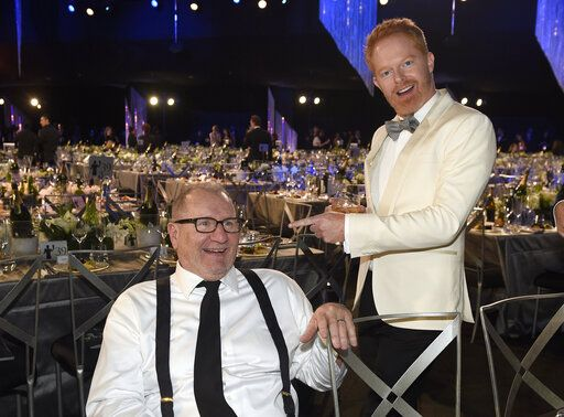 "FILE - In this Jan. 29, 2017, file photo, ""Modern Family"" cast members Ed O'Neill, left, and Jesse Tyler Ferguson attend the 23rd annual Screen Actors Guild Awards in Los Angeles. The popular comedy series ends its 11-season run with a two-hour finale on Wednesday. (Photo by Chris Pizzello/Invision/AP, File)"