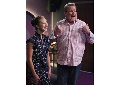 "This image released by ABC shows Aubrey Anderson-Emmons, left, and Eric Stonestreet in a scene from ""Modern Family.""  The popular comedy series ends its 11-season run with a two-hour finale on Wednesday. (Eric McCandless/ABC via AP)"