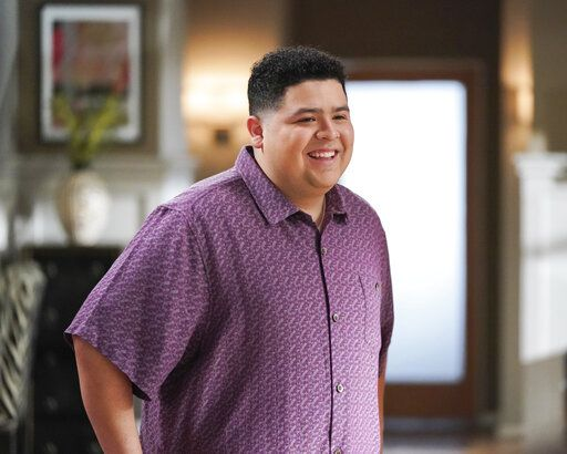 "This image released by ABC shows Rico Rodriguez in a scene from the comedy series ""Modern Family.""  The popular comedy series ends its 11-season run with a two-hour finale on Wednesday. (Eric McCandless/ABC via AP)"