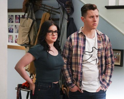 "This image released by ANC shows Ariel Winter, left, and Nolan Gould in a scene from ""Modern Family.""  The popular comedy series ends its 11-season run with a two-hour finale on Wednesday. (Eric McCandless/ABC via AP)"