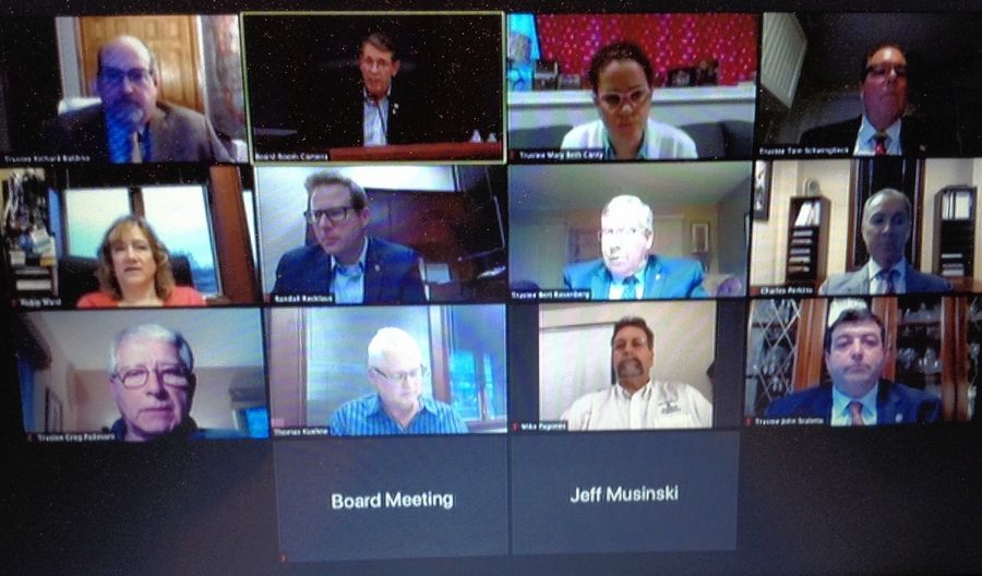 A virtual Arlington Heights village board meeting was held via Zoom conference Monday night. Mayor Tom Hayes, top row second from left, warned that police could begin issuing tickets to those who do not follow social distancing guidelines.