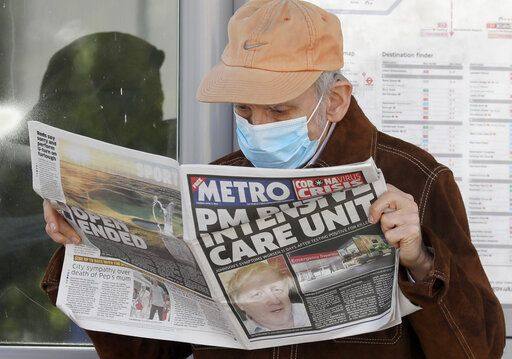 A man reads a newspaper with the headline: 'PM in intensive care', outside St Thomas' Hospital in central London as British Prime Minister Boris Johnson is in intensive care fighting the coronavirus in London, Tuesday, April 7, 2020. Johnson was admitted to St Thomas' hospital in central London on Sunday after his coronavirus symptoms persisted for 10 days. Having been in hospital for tests and observation, his doctors advised that he be admitted to intensive care on Monday evening. The new coronavirus causes mild or moderate symptoms for most people, but for some, especially older adults and people with existing health problems, it can cause more severe illness or death.
