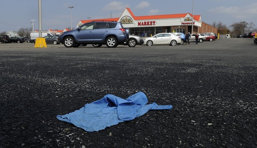Improperly discarded gloves, like this one in a grocery store parking lot in Palatin, and masks can pose a health risk.