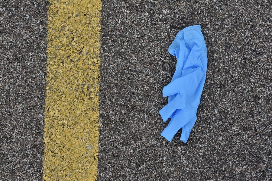 A used disposable glove in the parking lot near the Fresh Thyme grocery store in Geneva was left on the ground instead of being disposed of properly.