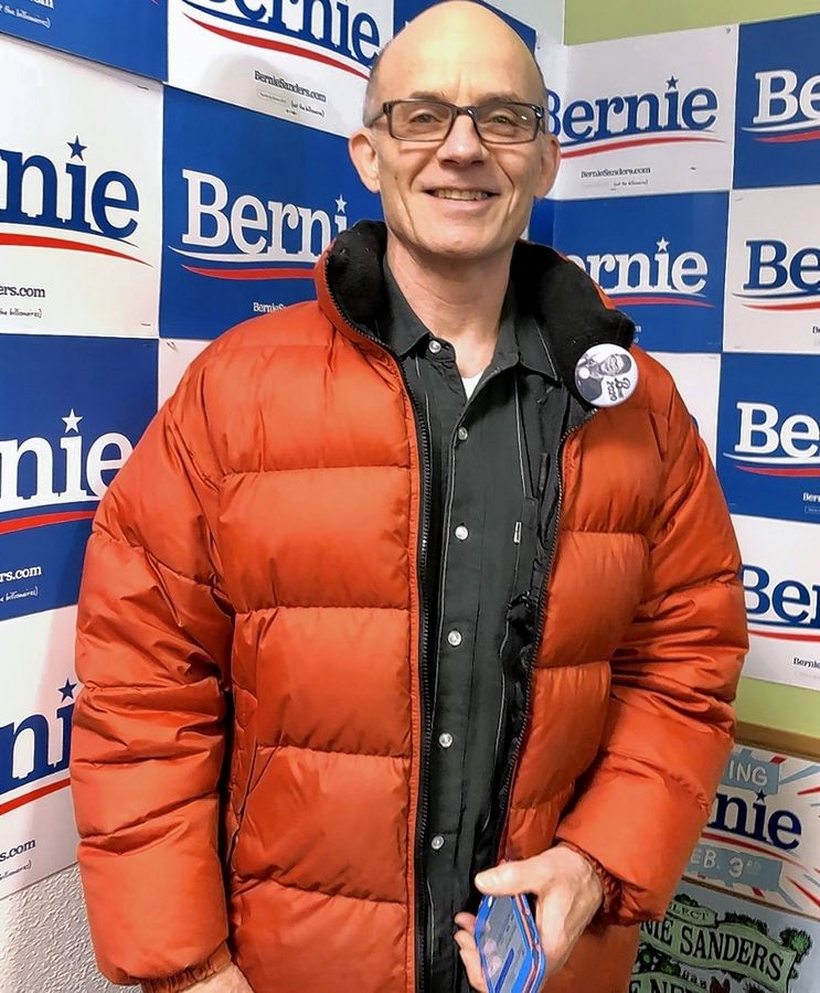 Wheaton resident Dan Bailey waits for a campaign rally to start for Sen. Bernie Sanders in Iowa in February but said he'll support former Vice President Joe Biden in order to elect a Democrat as president.