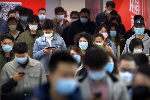 "Commuters wear face masks to protect against the spread of new coronavirus as they walk through a subway station in Beijing, Thursday, April 9, 2020. China's National Health Commission on Thursday reported dozens of new COVID-19 cases, including most of which it says are imported infections in recent arrivals from abroad and two ""native"" cases in the southern province of Guangdong."