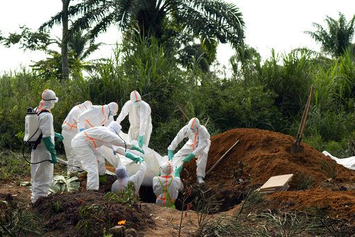 FILE - In this Sunday, July 14, 2019 file photo, an Ebola victim is put to rest at the Muslim cemetery in Beni, Congo. These African stories captured the world's attention in 2019 - and look to influence events on the continent in 2020.