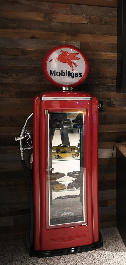 A customized, vintage gasoline pump is now a cabinet to hold Leadinham's collection of smaller cars.